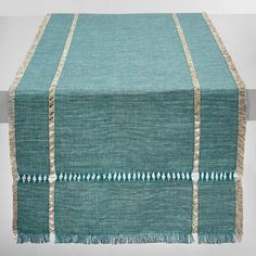 Hand woven in India of 100% cotton in a teal melange, our khadi runner features pulled thread embroidery and soft fringe on all four sides. Layer…