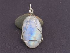 Hey, I found this really awesome Etsy listing at http://www.etsy.com/listing/180401732/rainbow-moonstone-wire-wrapped-in-silver