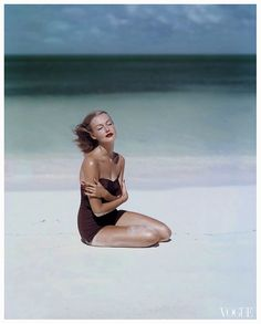 Liz Benn models a strapless swimsuit by Givenchy, for Vogue 1953