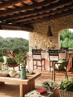 Earth tones prevail on the stone and terra cotta porch of this Girona farmhouse by designer Gemma Mateos. Photo via Gemma Mateos.