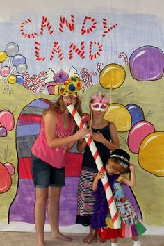 Candyland photo booth. Use butcher paper against the wall and decorate to turn any wall into a photo booth.