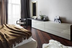 Bedroom Among Taupe Duvet under Kiev Apartment by Soesthetic Group Glossy Wooden Storage Feat Flower Also Mirror Applied