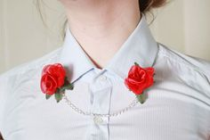 Backing Pins - similar to a safety pin, but with a flat metal backing  Silk or fabric flowers with wire stems  Jewellery pliers (or thin needle nose pliers with a cutting blade)  A length of chain - 20 to 30cm should be plenty