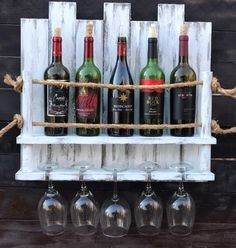 Custom designed & made! The use of rope and your choice of an exotic wood, personalized name plate that secures the wine bottles in place make these wine racks very custom and unique!