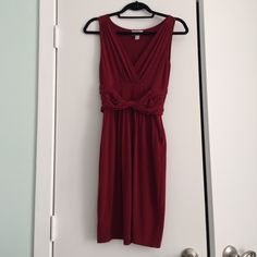 "Red LOFT dress Deep red, polyester dress. Very comfortable (and easy to pack!). Has pockets. Small ""nubby"" area on left hand side, but not too noticeable (as pictured). Please feel free to make an offer! LOFT Dresses"