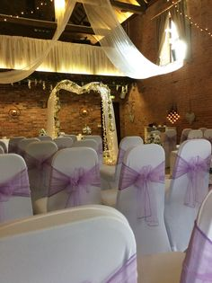 purple and peacock green chair sash tied in an elaborate bow to the