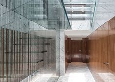 This patterned glass staircase by Carpenter Lowings forms the centrepiece of an apartment in Hong Kong, and leads to a giant skylight with access to a roof.