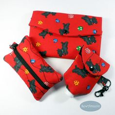 Playful Scotty Dogs Accessory Gift Set: Arooo! These adorable black Scottish terriers are having a grand time chasing colorful balls on this 3 piece accessory gift set. The red fabric print on each piece is accented by lining fabric withwhite text doggie phrases on a black background. Great gift idea for Scottie lovers! The gift set includes 3 matching pieces: