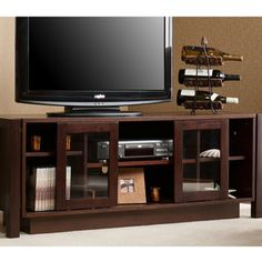 @Overstock - This espresso finished media console cabinet is the perfect option for those upgrading their home entertainment centers. The cabinet has adjustable shelves for organizing electronic components and media and will hold up to a 50 in. flat panel TV.    http://www.overstock.com/Home-Garden/Burnell-Espresso-TV-Media-Stand/2405179/product.html?CID=214117 $237.99