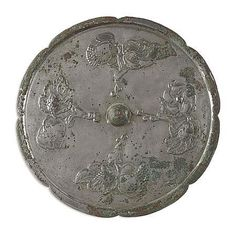 CHINESE SILVERED BRONZE MIRROR  TANG DYNASTY  of scalloped form, decorated in relief with stylised plant forms   19cm diam