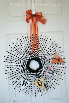 Paper straw Halloween wreath & banner. Love but only work inside in our wet weather.