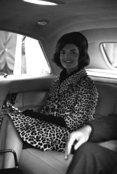 FIRST LADY JACQUELINE KENNEDY wearing her famous leopard skin coat as inspired by one owned by Queen Elizabeth.