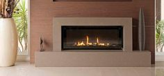 Jetmaster Heat n Glo XLR Plus Gas Fireplace with Martini Front Fascia in Ebony Black with Fibre Stones media
