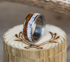 One of a kind wood and antler wedding ring.