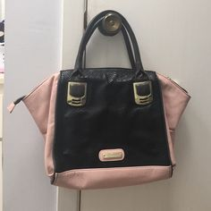 Cute Steve Madden Purse Excellent condition... Black and Pink Leather Steve Madden Purse.. Large... Gold hardware.. Clean...  Trade value $60 Steve Madden Bags