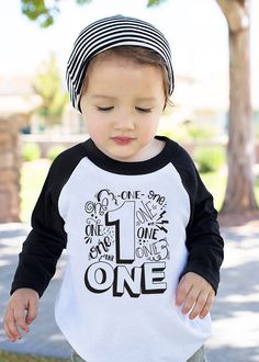 "Your little boy is turning one year old! Let him celebrate in style with this playful and funny t-shirt created just for him. Featuring the phrase, ""I'm 1, let's party!"" your little one will be stylish in one of our cozy tees. This tee will surely be the life of the party. Whether you are dressing your baby for a big family party or simply having an intimate celebration at home, this adorable tee will make your day. Each cozy tee is Super Soft Poly Cotton tees. We use top quality, durable…"