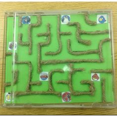 Handmade maze! :). So easy to make!  Cd jewel case, twine, hot Glue, pictures/stickers and bead! Took me 45 minutes last night!