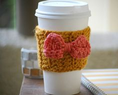 Crochet Coffee Cozy in Mustard with Cute Coral Bow on Etsy, $7.50