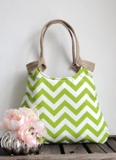 Chevron green & burlap  tote bag. $65.00, via Etsy.  Loving the Chevrons and the shape of this bag.  I also like her idea of using the jute strapping for handles. Nicely done!
