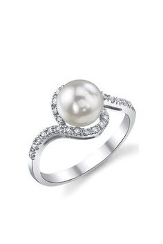 white gold, pearl, diamonds. Too many diamonds for my taste but still beautiful