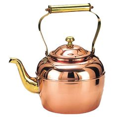 Copper-finished stainless steel tea kettle with brass handle and spout.  Product: Tea kettleConstruction Material: