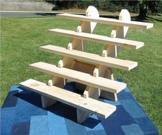5-Shelf display stand:  20.5 high x 24 wide x 19.5 deep Each shelf: 24 wide x 3.5 deep 3.5 between each shelf (4.5 from table to first shelf)