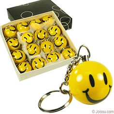 SOLID RESIN SMILEY FACE KEYCHAINS. Includes split keyring. Assorted colors. Makes great Christmas stocking stuffers and Halloween giveaways. (16 pieces per unit) Size 1 Inch ball, 2 Inch keychain
