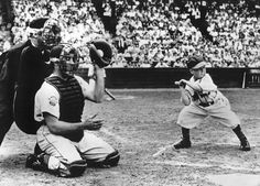 "Eddie Gaedel Becomes The Only Little Person To Play Major League Baseball.  At 3'7"" tall, Eddie Gaedel had a nearly invisible strike zone, which (along with selling tickets) is just what St. Louis Browns owner Bill Veeck had in mind when he staged this publicity stunt. Gaedel was under orders not to swing and he walked on four pitches. He was immediately pinch-run for, and his jersey (number ""1/8"") currently hangs in the Baseball Hall Of Fame."