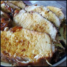 Pork Loin-onion, garlic, brown sugar-better than the crockpot with apples and onions, but a pain to clean the dish