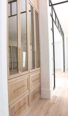 Modern kitchen design rift sawn white oak cabinets with waterfall double island and black shiplap hood