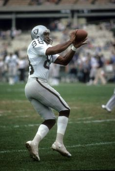 Tight End Raymond Chester of the Oakland Raiders catches a pass in pregame warm ups during an NFL football game circa 1979 Chester played for the...