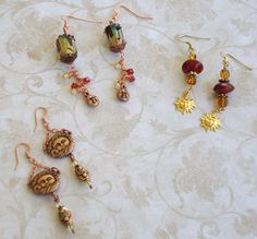 Sun Earrings .. left made with brass sun and copper & glass beads at bottom, middle beautiful glass bead with hanging sun and crystals, right glass beads with sun hanging from bottom .. Designed by Jann Tague .. Clever Designs .. https://www.facebook.com/#!/JewelsByJann
