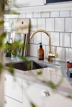 Kitchen with a golden touch - via cocolapinedesign.com gold tap