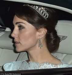 Kate wore a pale blue lace dress with a conservative, elegant neckline that ended just inches below her hair