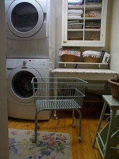 Love the warm cosy feel of this laundry.  I love the table/ironing table.