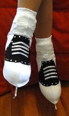 Skating to Grease, Rockin' Robin, or getting ready for the sock hop? These 50's saddle shoe figure skate boot covers will complete your look!. The tops of the socks are covered in lace to create a sock look, and the laces are silver hologram appliques. Want to add Swarovski rhinestones? Request a custom order, and I'll create a custom order with the right amount of rhinestones for you. These are the perfect ice skate boot covers for your program!