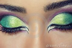 Closeup shot of a beautiful young woman's face with colorful eye makeup