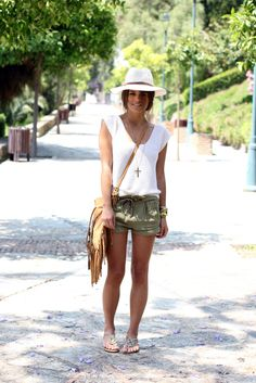 casual look: olive shorts and sleeveless sweater with hat and fringed bag