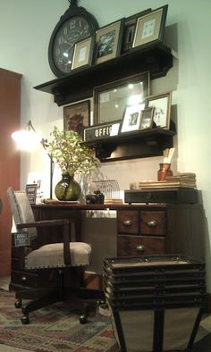 Love the use of a sweet gallary wall above this printers cabinet styled desk!