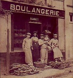 Boulangerie - firewood gathered for the days baking. The word 'Boulangerie' means the place (bakery) where bread is freshly baked. Resale retail bakeries do not have this signage, even if they bake previously made frozen bread dough on their premises.