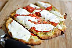 Simply Scratch » Pesto & Tomato Naan Personal Pizzas. A very similar version of this recipe was featured in the September 2014 Vandalizing the Kitchen Cooking Class Pizza Party.