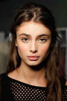 Natural makeup, full brows.