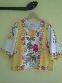 I have a 1920's pattern from Decades of Style that is very similar to this darling blouse.