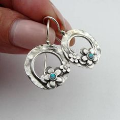 This listing reserved for Deborah One 925 sterling silver hoop earring in floral design from my Collection round Blue Opal stones Dimensions: Length: 27mm (hook included), Width: 18mm Labeled and stamped 925. This beauty will be sent to you with a simple modern recycled brown gift box.(All