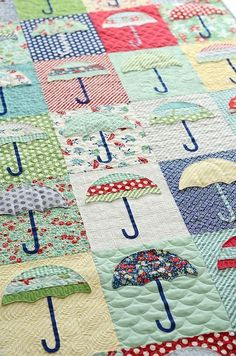 I'm not usually a fan of schoolhouse, sun bonnet sue type quilts but something about this raincheck quilt really appeals to me - great use of colour.