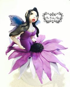 The purple flower fairy - made from fondant and edible lustre powder. Purple Flowers, Fondant, Disney Characters, Fictional Characters, Snow White, Powder, Fairy, Disney Princess, Fondant Icing