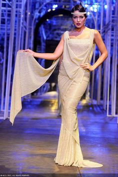 Miss Universe Canada Sahar Biniaz showcases a creation by designer Tarun Tahiliani during the Grand Finale of the India Bridal Fashion Week (IBFW) 2013, held in New Delhi.
