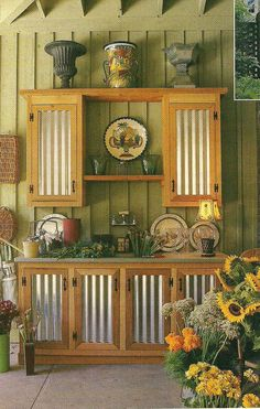 Outdoor cabinet using cedar and corrugated tin, could be used for many purposes . from Southern Living magazine 2000 Outdoor Kitchen corrugated tin Outdoor Kitchen Cabinets, Outdoor Kitchen Design, Diy Cabinets, Design Kitchen, Kitchen Layout, Kitchen Ideas, Rustic Outdoor, Outdoor Decor, Gardens
