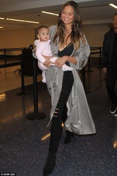Chrissy Teigen wearing J Brand Maria High Rise Jeans in Blackheart, Tony Bianco Diddy Boots and Zimmermann Winsome Robe Coat