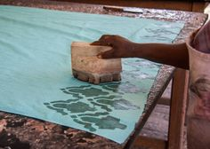 Stamping the wax onto the batik fabric